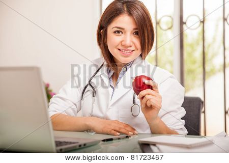 Pretty Nutritionist With An Apple