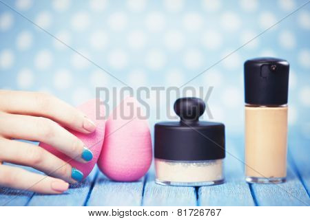 Female Hand And Beauty Blender.