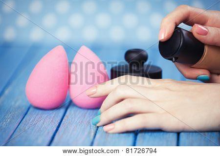 Female Hand And Beauty Blender.