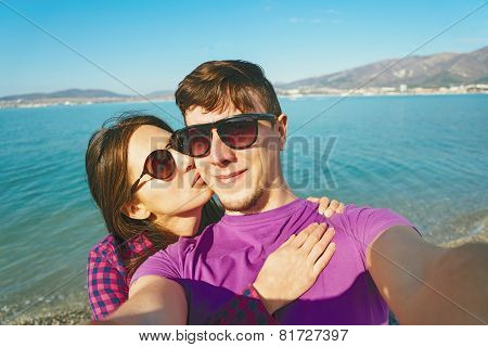 Loving Couple Taking Self-portrait On Beach