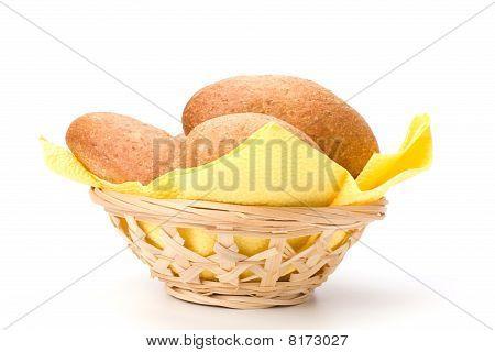 fresh warm rolls in breadbasket isolated on white background