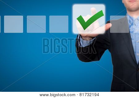 Businessman Touching Button and Ticking Check Box