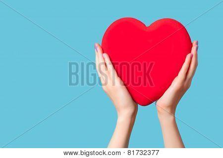 Hands Holding Shape Heart On Blue Background