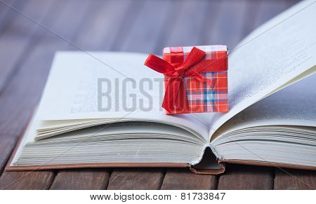 Gift Box On Opened Book.
