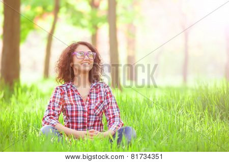 Indian Girl With Glasses In The Park.