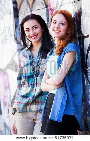 Two Girls Near Graffiti Wall.