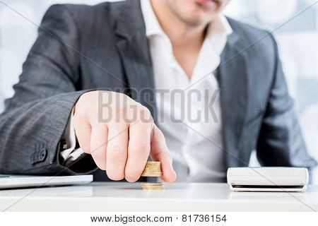 Successful Businessman Counting Money