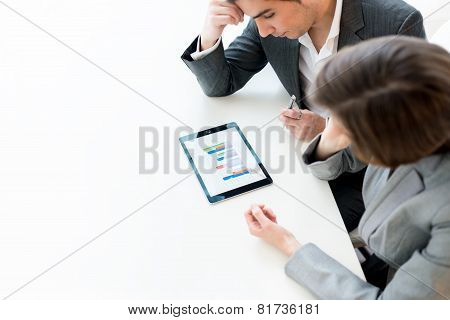 Business Colleagues Analysing A Graph