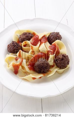 Fettuccine With Meat Balls On A Plate