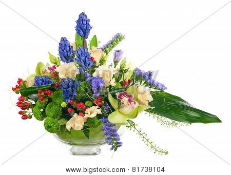 Bouquet From Orchids And Other Flowers In Glass Vase Isolated.