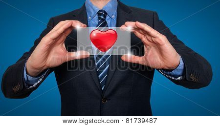 Heart in front of businessman - Stock Image