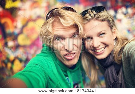 Young couple taking selfie of themselves