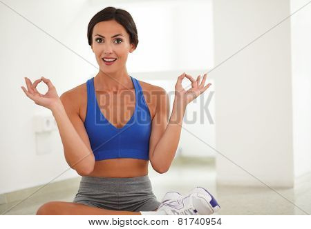 Young Pretty Woman Sitting In Lotus Position