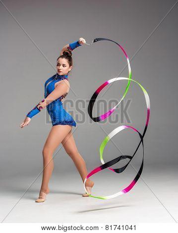 teenager doing gymnastics dance with ribbon