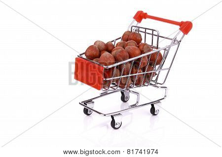 Nuts In Miniature Shopping Cart Isolated On White Background