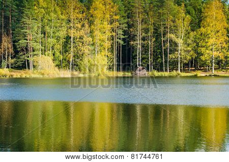 Autumn Landscape On The Lake In The Woods