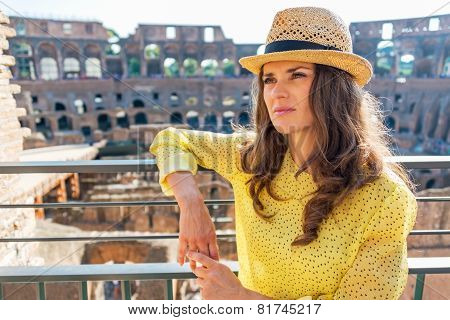 Portrait Of Young Woman In Colosseum In Rome, Italy