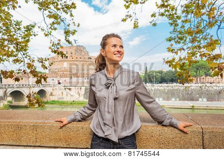 Portrait Of Happy Young Woman On Embankment Near Castel Sant'ang