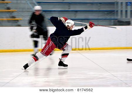 Hockey Player Shooting