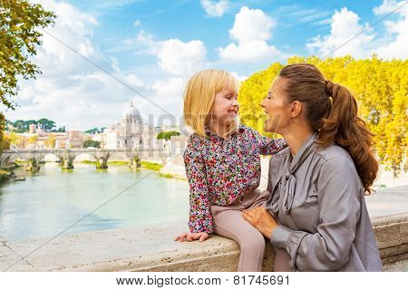 Happy Mother And Baby Girl On Bridge Ponte Umberto I With View O