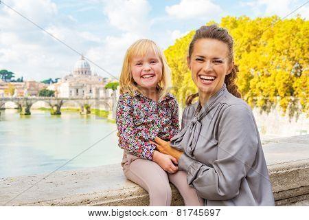 Portrait Of Happy Mother And Baby Girl On Bridge Ponte Umberto I