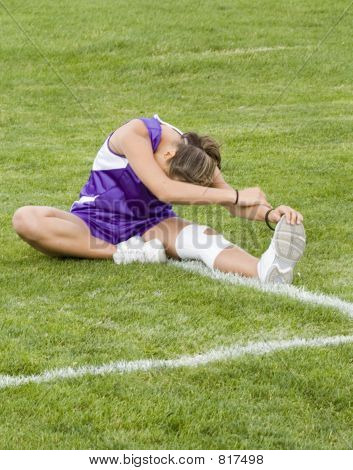 Stock Photo of a Cross Country Runner Stretching