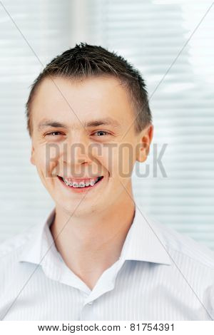 Smiling Young Man With Orthodontic Braces.