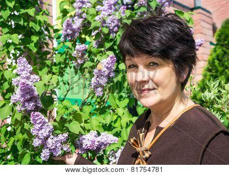 Portrait Of Woman Near Lilac