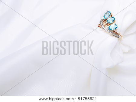 Golden Ring With Sapphire On Silk.