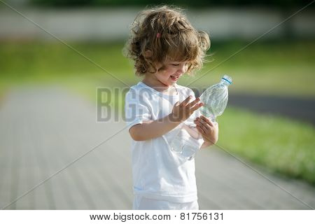 little girl drinking clean water from plastic bottle