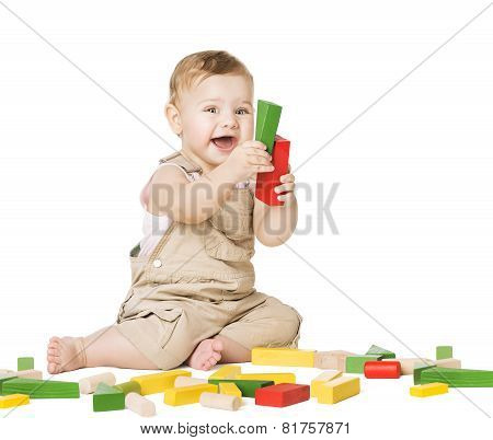 Child Playing Toys Blocks. Children Development Concept. Happy Baby Boy. Smiling Kid Isolated White