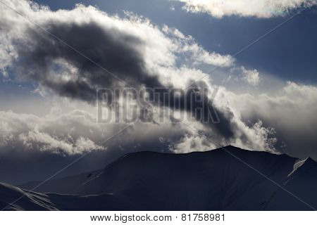 Evening Dark Mountain And Sunlight Clouds