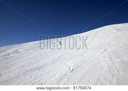 Skier On Slope In Sun Day