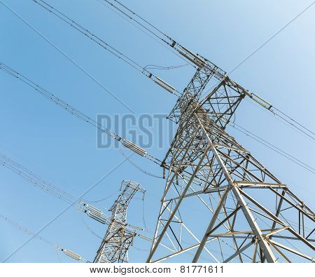 Power Transmission Tower Over Blue Sky