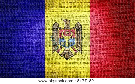 Moldova flag on burlap fabric