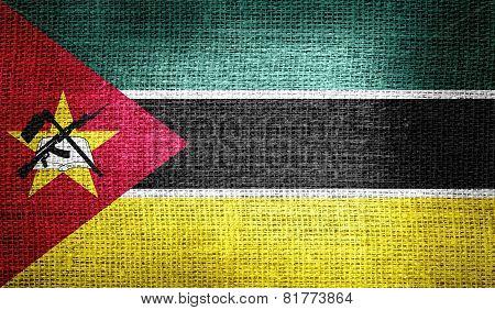 Mozambique flag on burlap fabric