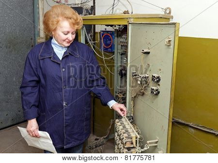 Woman Engineer In Machine Room (elevator)
