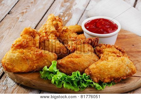 fried chicken wings in batter on the board