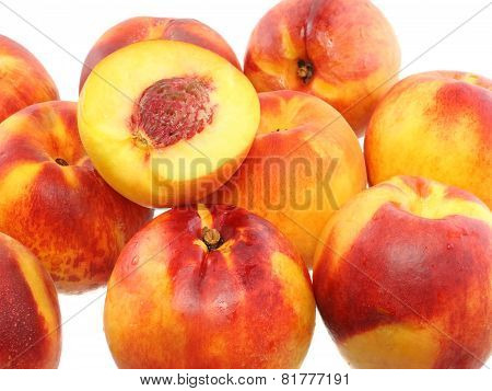 A Few Peaches With Slice Of One,on White.isolated