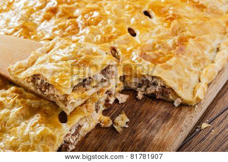 meat pie puff pastry cut on the board