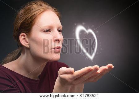 Woman Gives A Heart In A Kiss