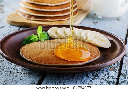 Pancake banana plate on a wooden surface