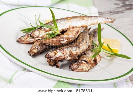 Grilled Sardines On Plate.