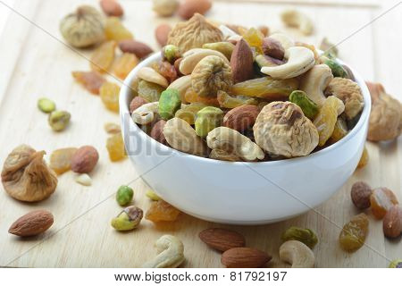 close up mixed nuts in white bowl