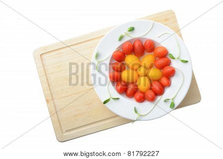 fresh cherry plum tomato on white plate isolated on white backgroundHealthy eating concept