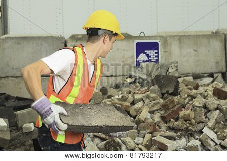 A worker who recycling thing on recycle center