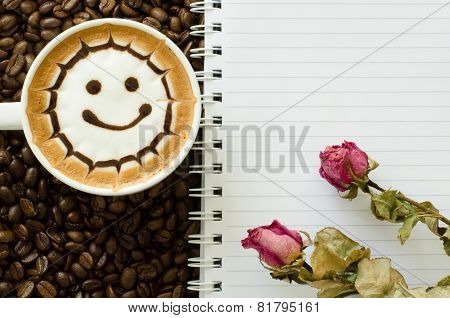 Latte Art And Notebook On Coffee Bean Background