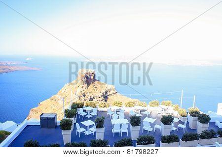 Skaros rock in Santorini against blue sea as a background