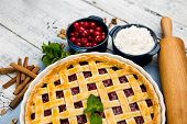 foto of cherry pie  - Homemade cherry pie on wooden table - JPG
