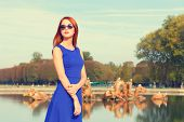 picture of versaille  - Redhead girl in sunglasses near lake in Versailles - JPG